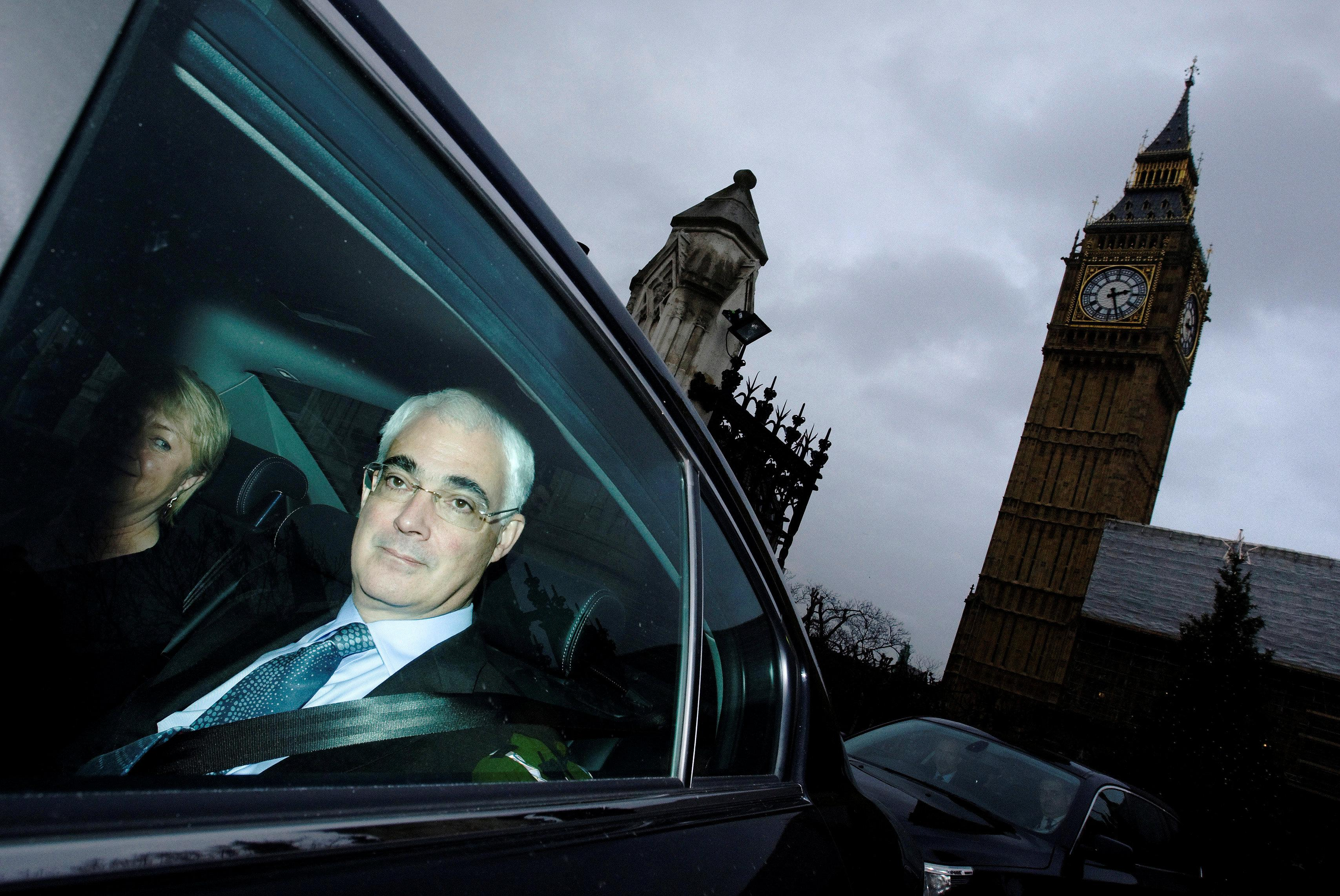 Alistair Darling, Britain's Chancellor of the Exchequer, leaves the Houses of Parliament after giving his pre-budget report, in London, Britain, December 9, 2009. Luke MacGregor/File photo