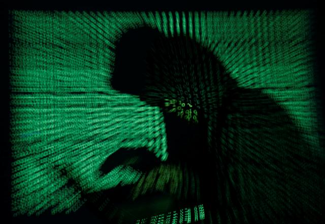 reuters.com - Reuters Editorial - Cyber attacks cost German industry almost $50 billion: study