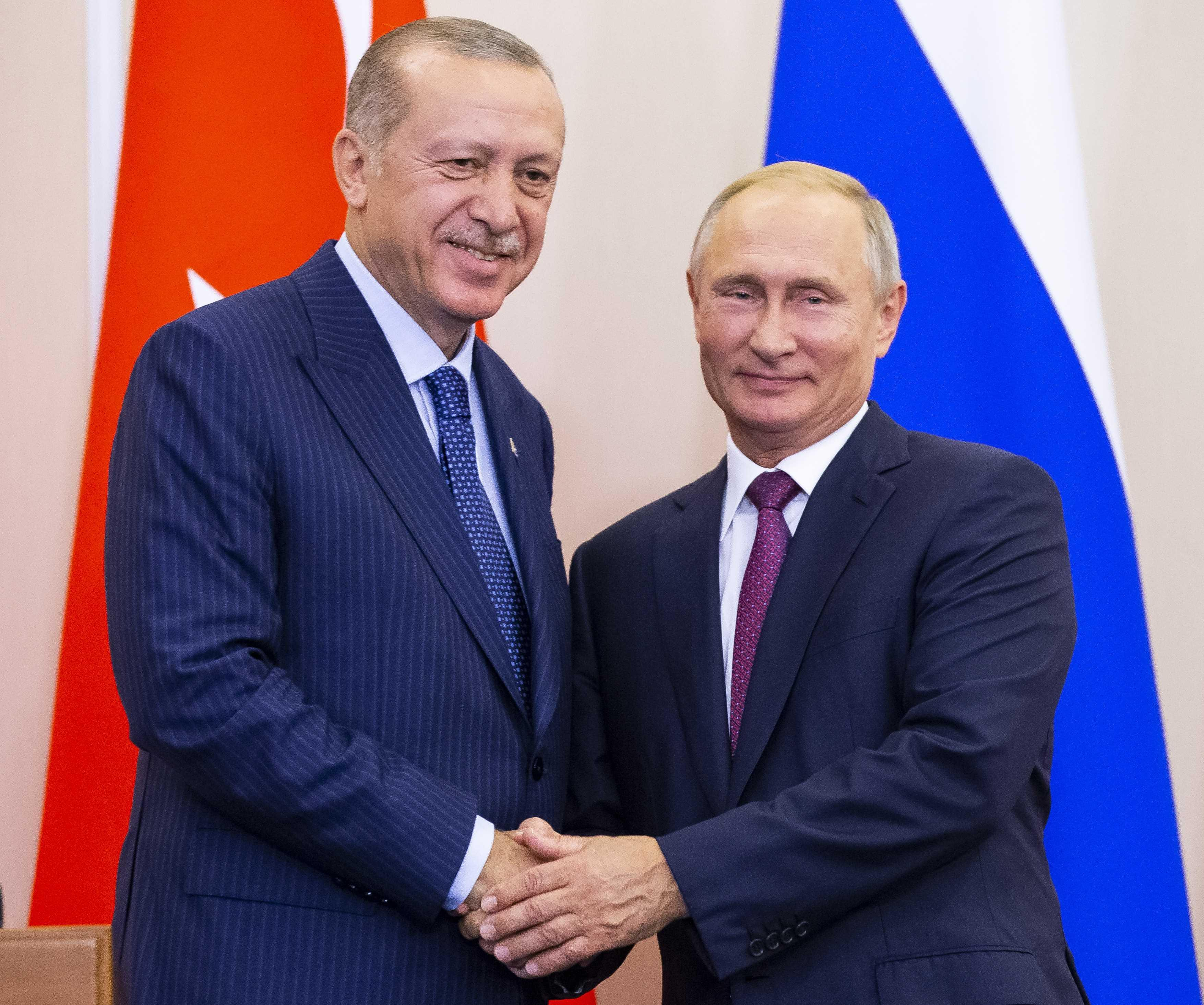Russian President Vladimir Putin (R) and his Turkish counterpart Tayyip Erdogan shake hands during a news conference following their talks in Sochi, Russia September 17, 2018. Alexander Zemlianichenko/Pool via