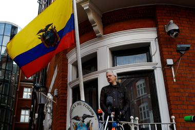 WikiLeaks founder Julian Assange is seen on the balcony of the Ecuadorian...