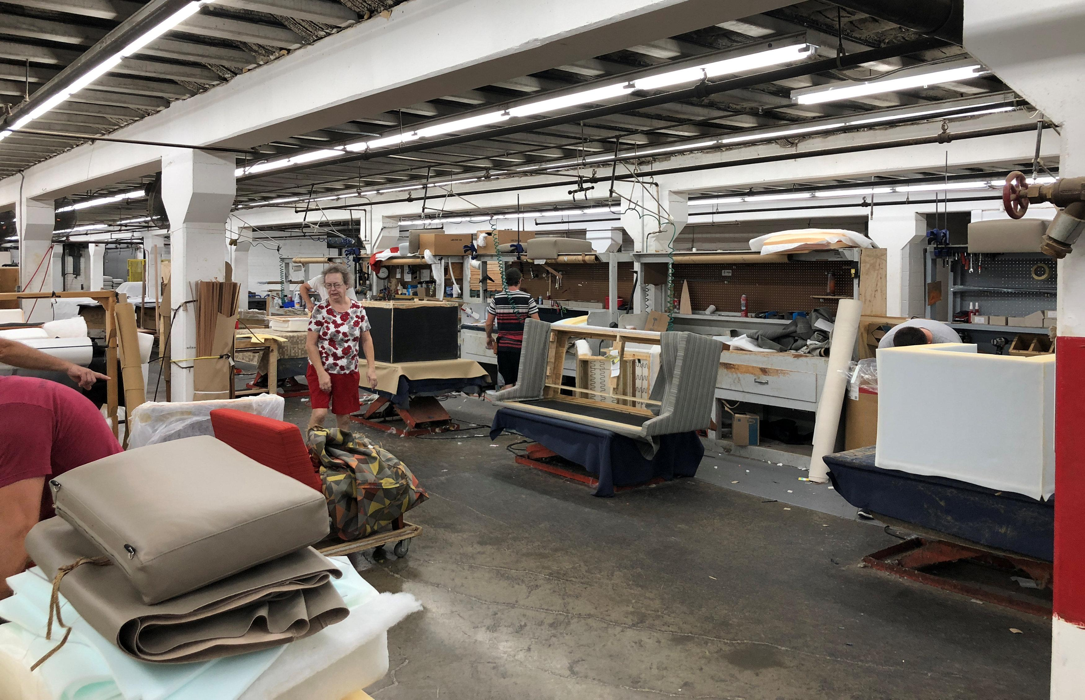 The assembly line at Bernhardt Furniture Company where the focus has shifted to upholstered and other goods that allow greater customisation, and can't be outsourced abroad is shown in Lenoir, North Carolina, U.S., August 15, 2018.   Howard Schneider