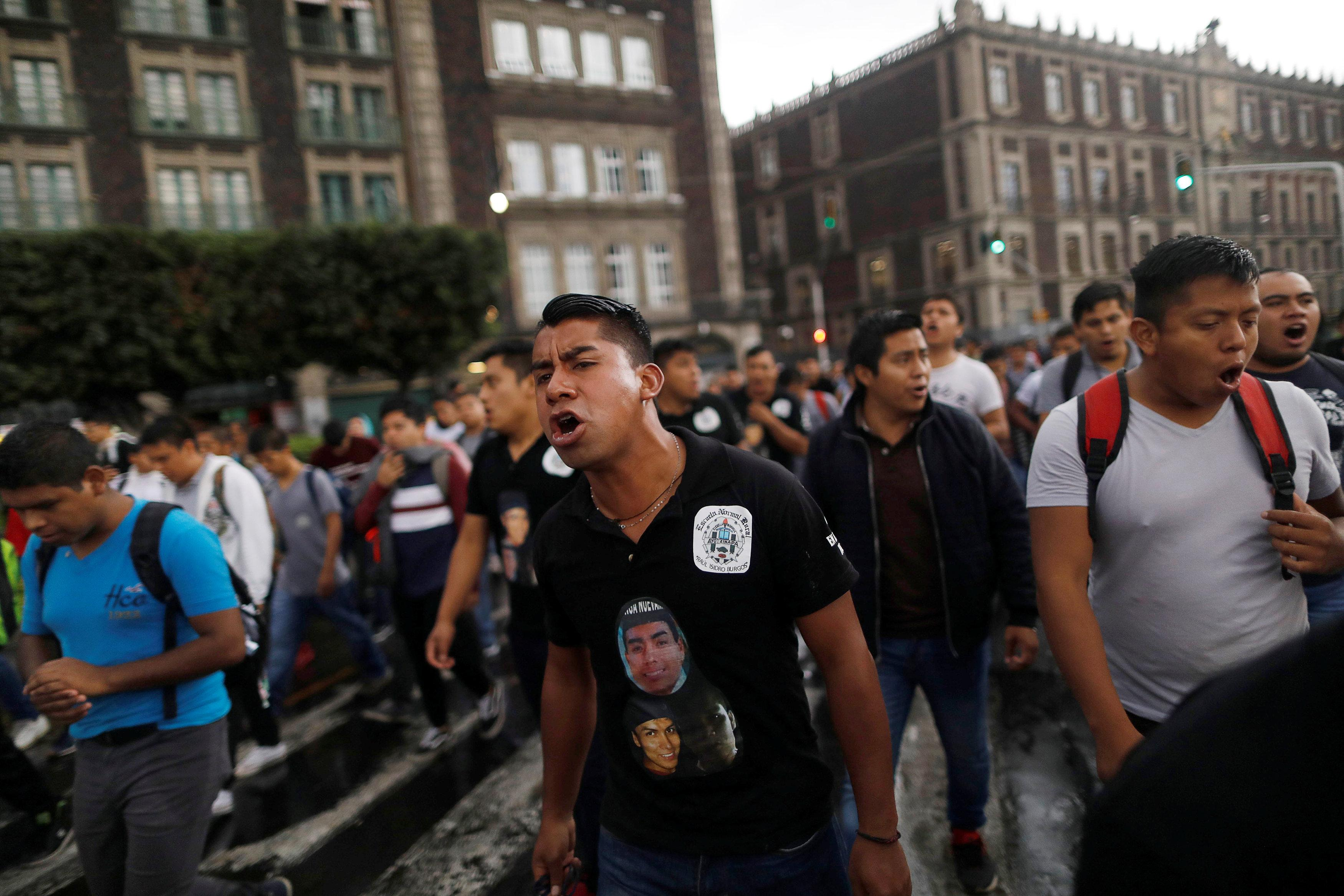 A demonstrator yells during a march to mark the fourth year since the disappearance of the 43 students of training college Raul Isidro Burgos in the state of Guerrero, in Mexico City, Mexico September 26, 2018. Edgard Garrido