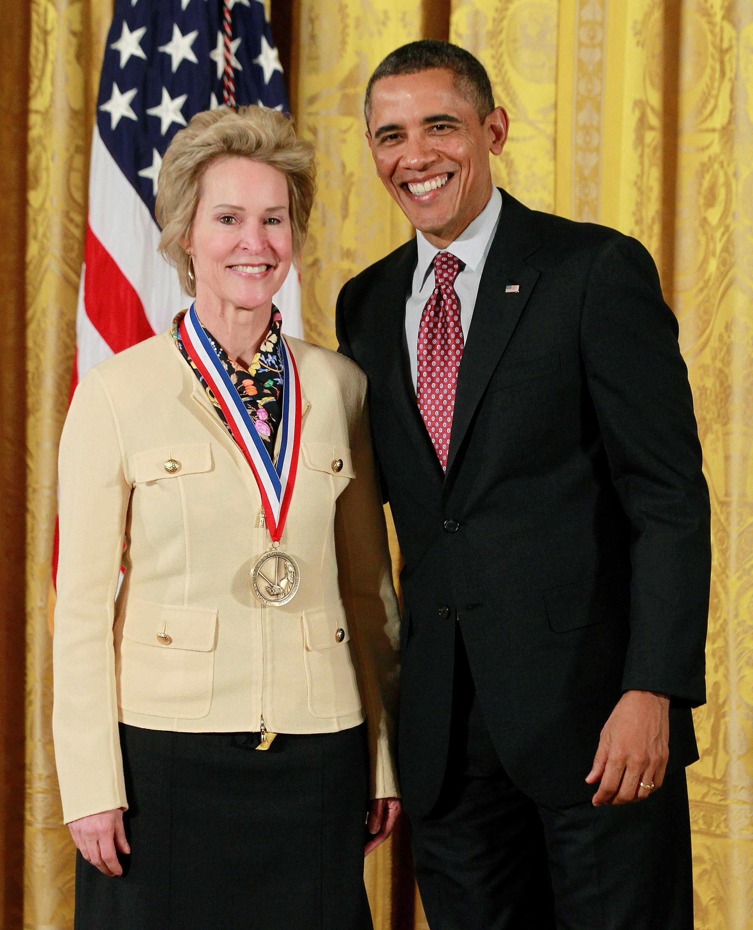 U.S. President Barack Obama presents the National Medal of Technology and Innovation to Dr. Frances Arnold from the California Institute of Technology during a ceremony in the East Room of the White House in Washington, February 1, 2013. Jason Reed