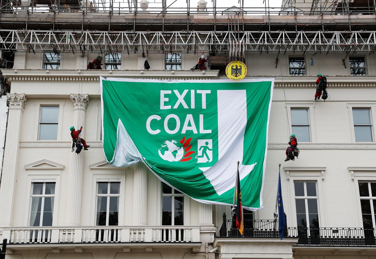 greenpeace activists scale german embassy in london to. Black Bedroom Furniture Sets. Home Design Ideas