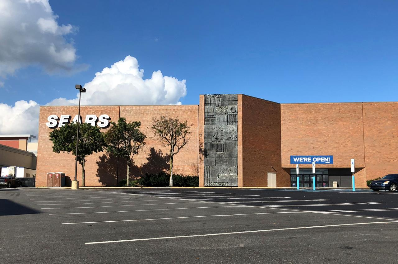 b2c92a7a785 Sears store is pictured with a sign indicating the store remains open  during the ongoing redevelopment of the neighboring Granite Run Mall in  Media, ...