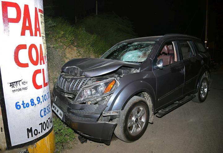 The damaged vehicle of Vivek Tiwari, a sales manager for Apple, is seen...