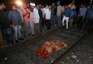 Commuter train runs over crowd in India