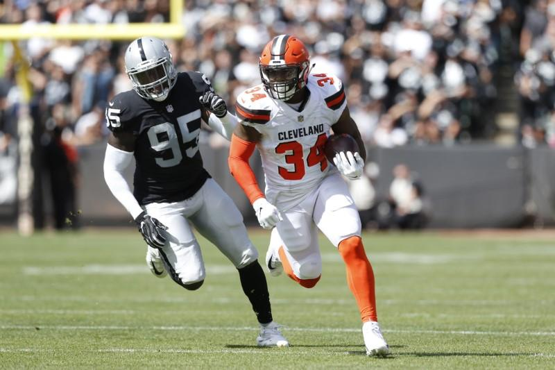 c17b40c0573 Sep 30, 2018; Oakland, CA, USA; Cleveland Browns running back Carlos Hyde  (34) runs the ball against the Oakland Raiders in the first quarter at  Oakland ...