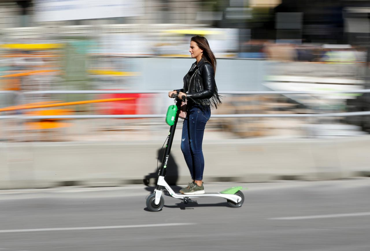 A Woman Rides Dock Free Electric Scooter Lime S By California Based Bicycle And Sharing Service On Street In Madrid Spain October 24