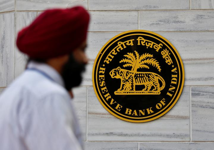 People walk past the Reserve Bank of India (RBI) head office in Mumbai
