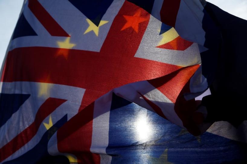 reuters.com - Reuters Editorial - Draft Brexit deal ends Britain's easy access to EU financial markets
