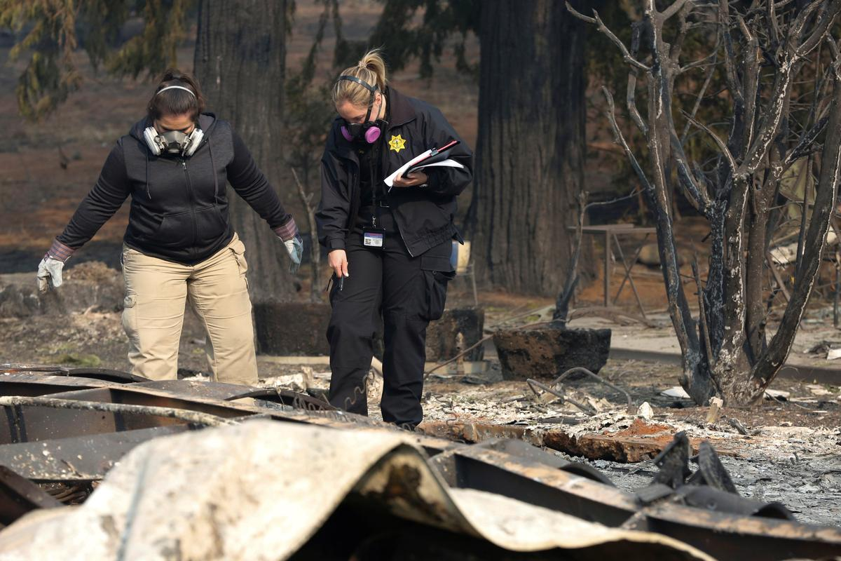 Some California wildfire victims may never be found: searcher