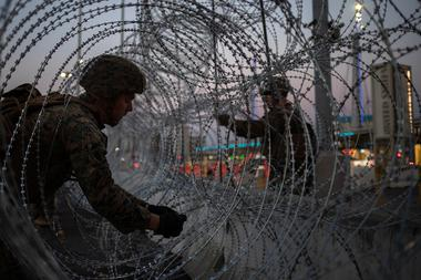 Marines fortify concertina wire along the San Ysidro Port of Entry border...