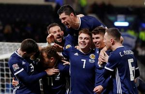 Forrest treble earns Scotland promotion, Serbia also through