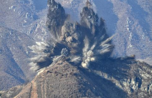 North and South Korea blow up guard posts to ease border tensions