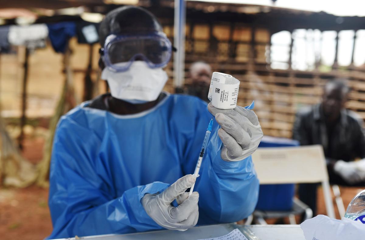 Gunfire, threats and curfews slow Congo's fight against Ebola