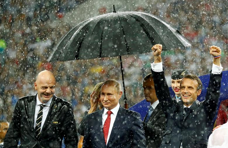 FIFA president Gianni Infantino, President of Russia Vladimir Putin and President of France Emmanuel Macron during the presentation of the World Cup trophy to France, after they defeated Croatia to win the final in Moscow, July 15. REUTERS/Kai Pfaffenbach