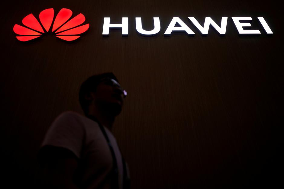 Exclusive: White House mulls new year executive order to bar Huawei on