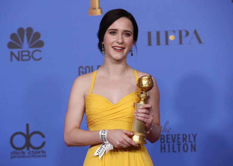 Rachel Brosnahan poses backstage with her award for Best Performance by an Actress in a Television Series, Musical or Comedy for The Marvelous Mrs. Maisel.     REUTERS/Mario Anzuoni