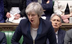 Parliament rejects May's Brexit deal