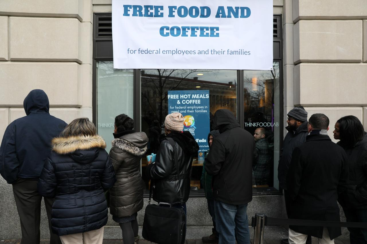 The extended partial government shutdown stand in line for fresh food and coffee at the world central kitchen a volunteer emergency kitchen run by chef
