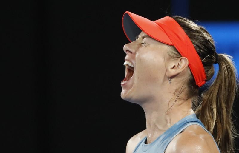 Aggressive Sharapova eliminates holder Wozniacki in Melbourne