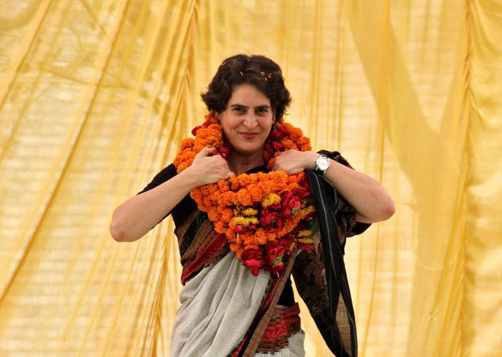 FILE PHOTO: Priyanka Gandhi Vadra adjusts her flower garlands during an...