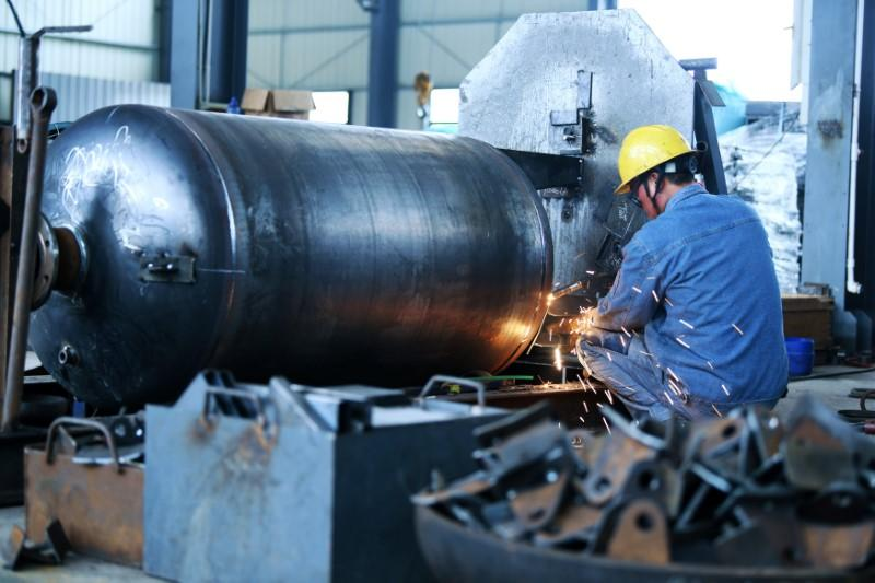 China's industrial profits shrink again in Dec  on weak