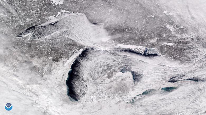 A satellite image of the Great Lakes showing parallel rows of cumulus clouds,, also known as 'cloud streets' streaming over the lakes' surface caused by frigid weather, on Sunday.    NOAA/via REUTERS
