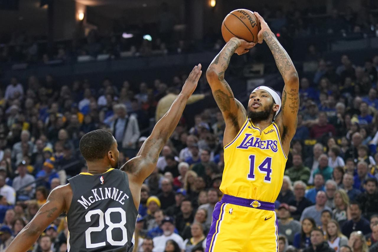 dcecd5c947c ... forward Brandon Ingram (14) shoots the basketball against Golden State  Warriors forward Alfonzo McKinnie (28) during the first quarter at Oracle  Arena.