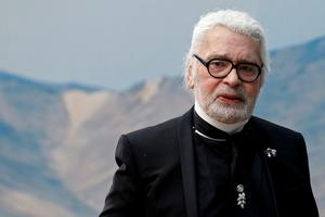 FILE PHOTO: German designer Karl Lagerfeld appears at the end of his...