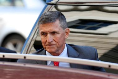 FILE PHOTO: Former National Security Adviser Flynn arrives for status...
