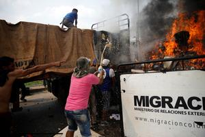 Venezuelan troops block aid convoy with bullets and tear gas