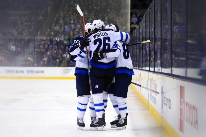 NHL roundup: Jets' Wheeler scores four in beating Jackets