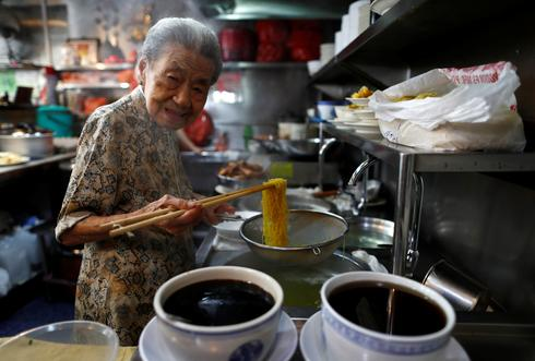Ageing noodle vendor helps keep Singapore foodie culture alive