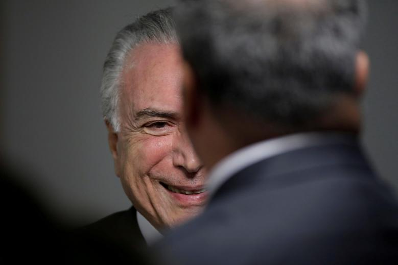 Brazil's President Michel Temer smiles during a ceremony to launch a new system of environmental fines, to benefit the Sao Francisco and Parnaiba River basins, at the Planalto Palace in Brasilia, Brazil March 12, 2018. REUTERS/Ueslei Marcelino