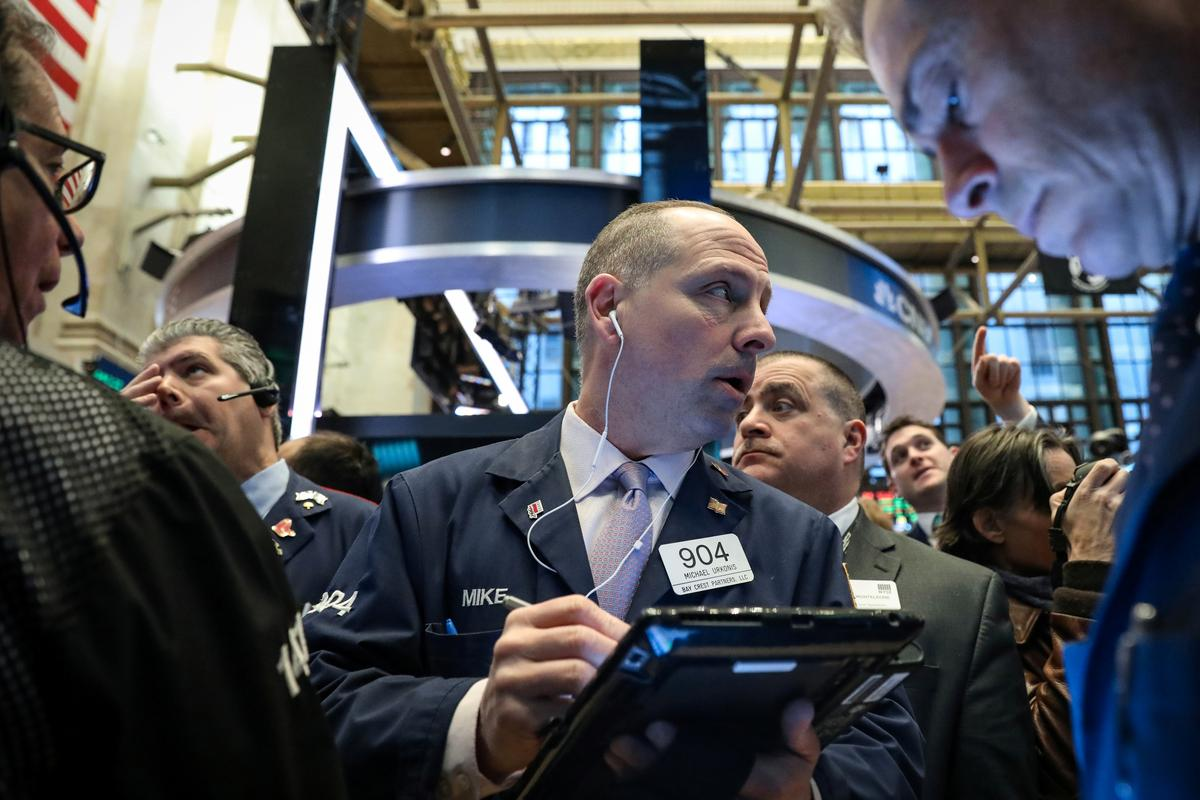 Wall Street rises after tame inflation supports patient Fed; Boeing drags Dow