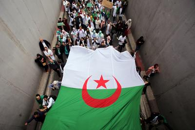 Algerians demand president ends 20-year rule