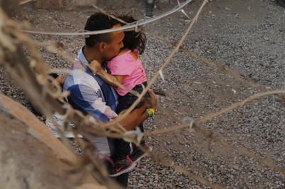 Migrants held under El Paso border bridge