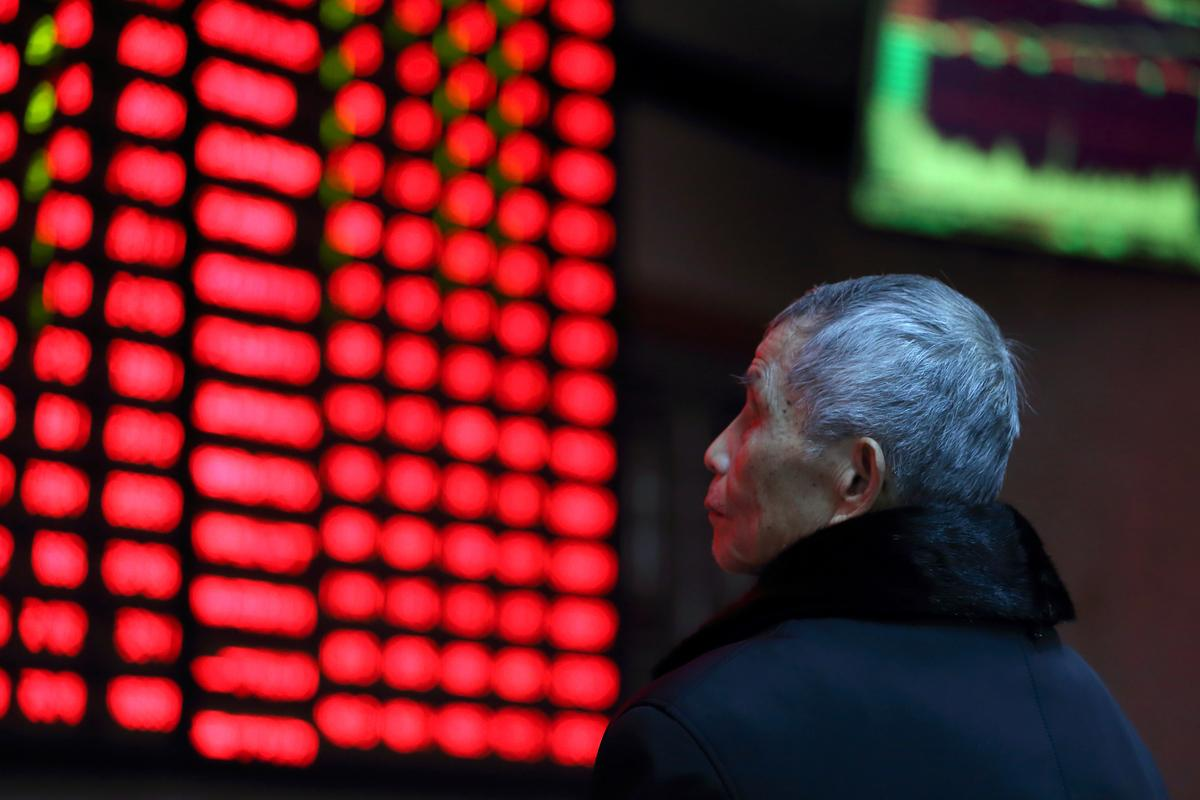 Asia stocks cling to nine-month high on China hopes, Wall Street dented by earnings