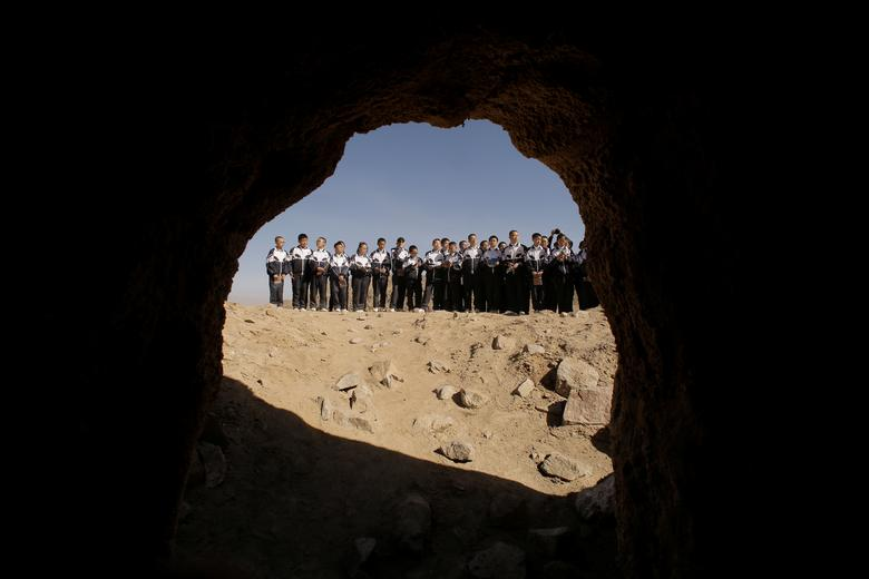Students are seen from inside an installation representing a cave on Mars at the C-Space Project Mars simulation base in the Gobi Desert, April 17. REUTERS/Thomas Peter
