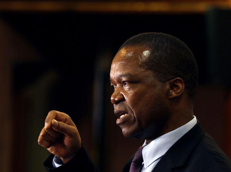 Zimbabwe central bank sees official, black market exchange rates...