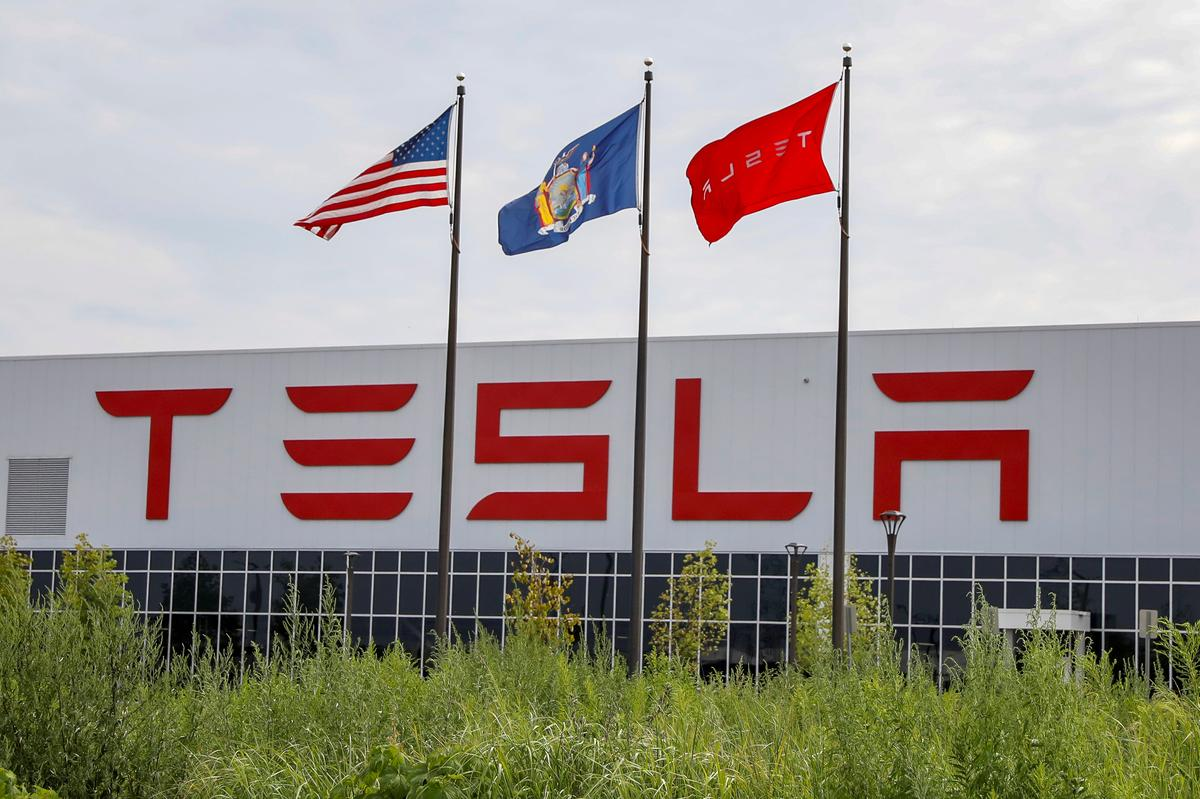 Exclusive: Tesla's solar factory is exporting most of its cells -...