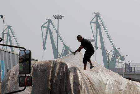 China rebuffs Trump claim U.S. tariffs are making firms leave