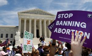 Abortion rights activists rally against new state bans