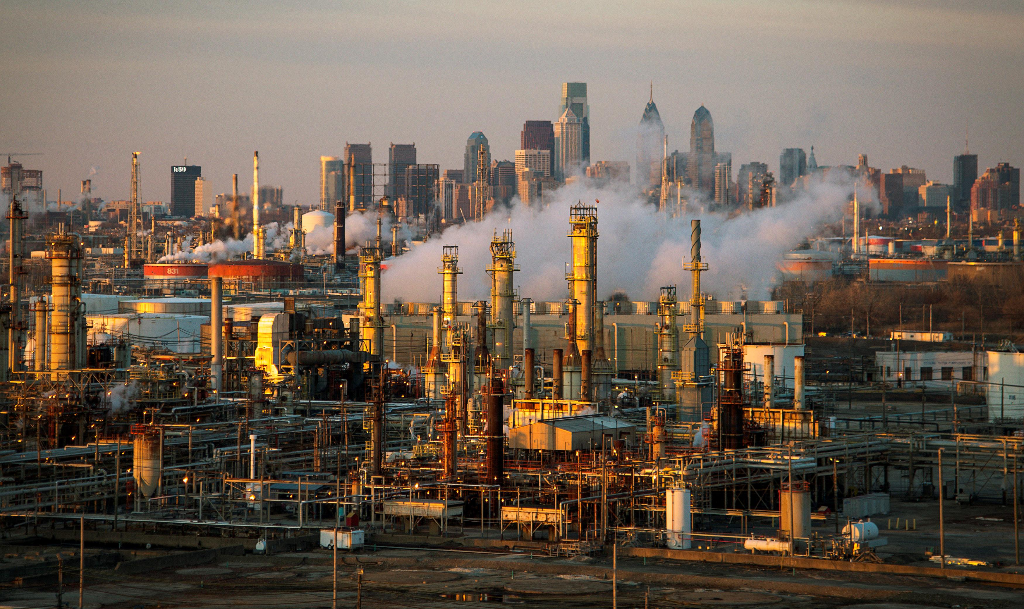 The Philadelphia Energy Solutions oil refinery owned by The Carlyle Group is seen at sunset in front of the Philadelphia skyline March 24, 2014.  David M. Parrott