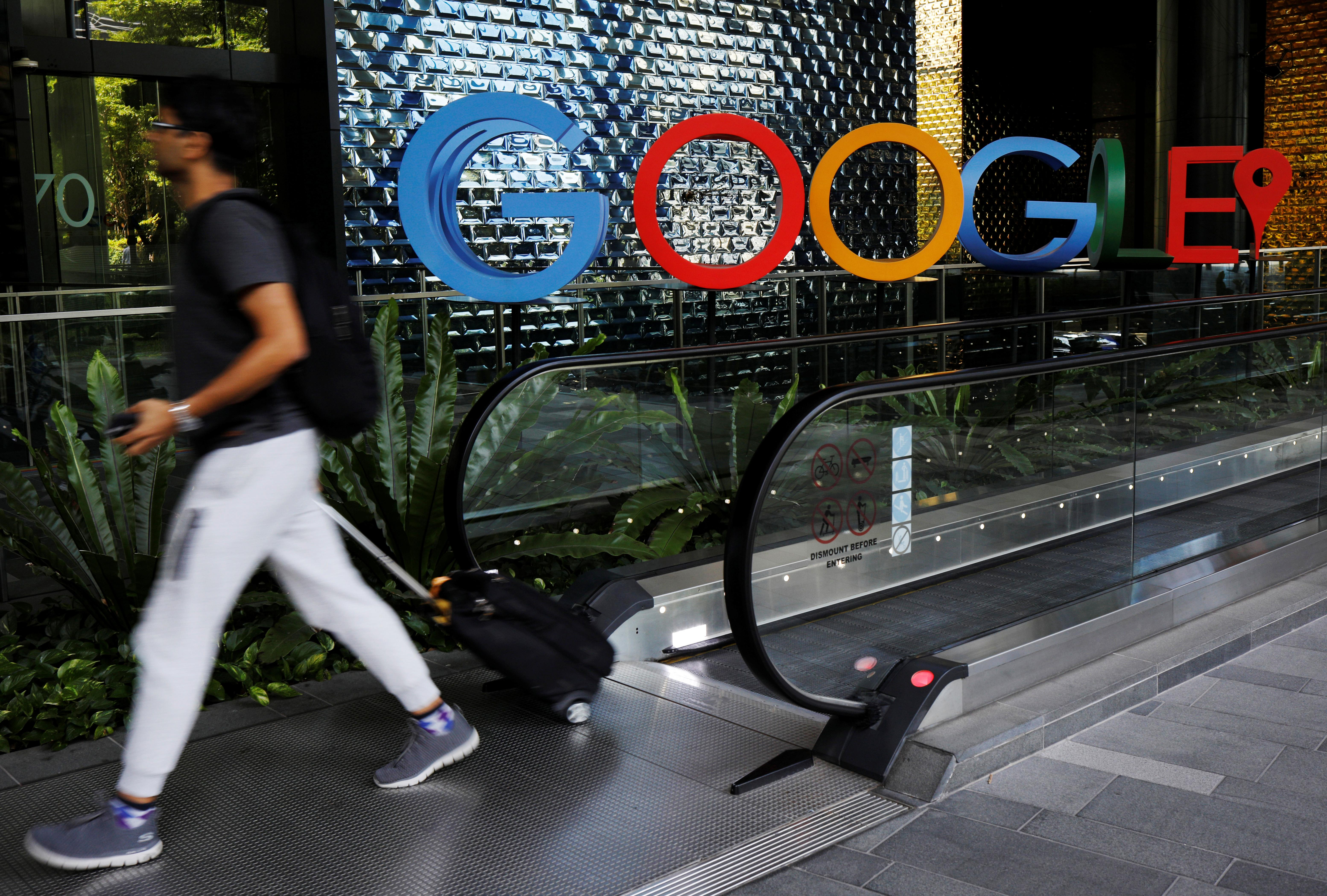 A man passes a Google signage outside their office in Singapore May 24, 2019. Edgar Su