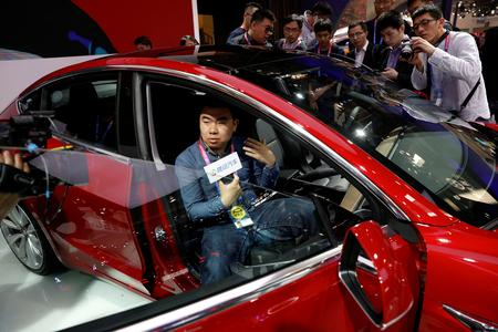 Tesla promotes lower priced China-made Model 3 in sales push