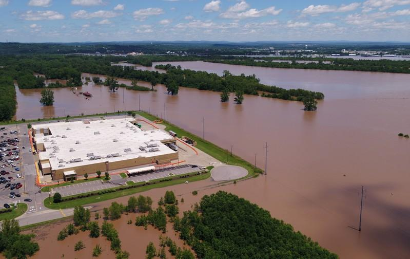 One levee breached, others overflowed in rain-soaked Central