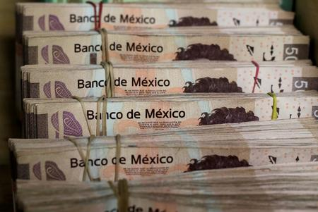 UPDATE 2-In double whammy, Fitch downgrades Mexico and Moody's lowers outlook